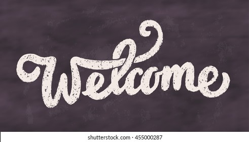 Welcome chalkboard sign.
