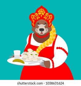 Welcome to Russia. Russian bear and Vodka and dumplings. National food. Tradition of meeting guests. Hospitality. Beast in national costume. ethnic Historical hat Kokoshnik with Khokhloma painting.