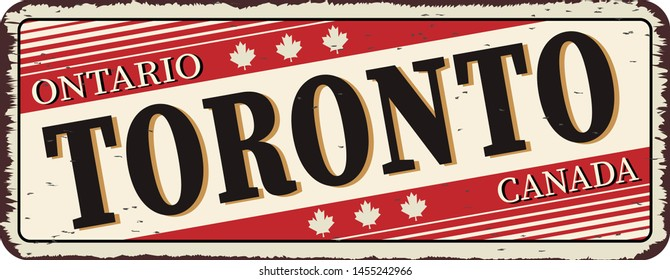 Welcome to Toronto Canada rusty old enamel sign on white background
