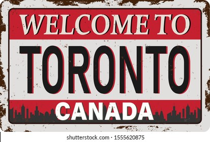 Welcome to Toronto Skyline Canada rusty old enamel sign on white background