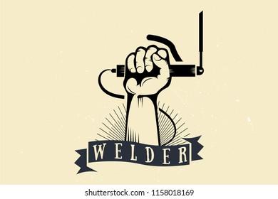 welder, emblem, badge. hand holding a pen with an electrode.
