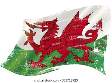 Welsh grunge waving flag. A grunge flag of Wales with the red dragon in the wind