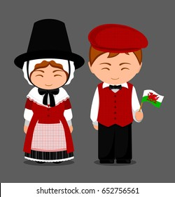 Welsh in national dress with a flag. Man and woman in traditional costume. Travel to Wales. People. Vector flat illustration.