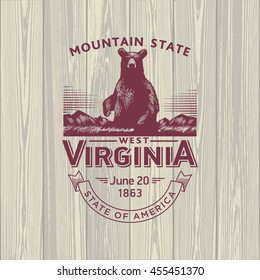 West Virginia Mountain State, stylized emblem of the state of America, bear, black, on wooden background