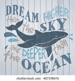 Whale on wood board, dream higher than the sky and deeper than the ocean