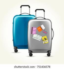 Wheeled plastic suitcases with baggage travel tags on white