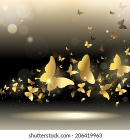 whirlwind of gold butterflies on a dark background