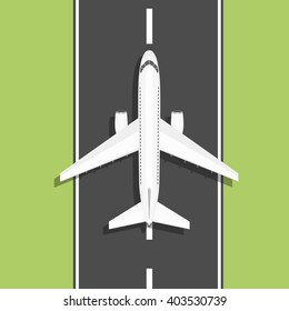 White airplane rides on the runway