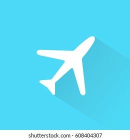 White airplane with shadow on blue background