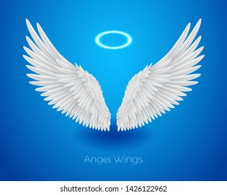 White angel wings and shining nimbus, halo, realistic feathers, vector illustration isolated on blue background