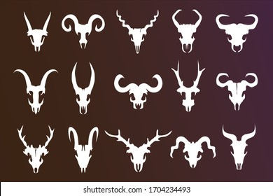 White animal skulls with horns. Head silhouette of buffalo, doe, goat, mutton, deer or fictional creatures. Skeletons of wild mammals with antlers.