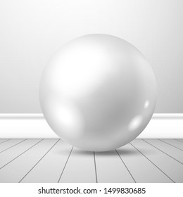 White ball with a shiny surface near a wall on plank floor. Mockup for design