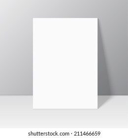 White blank stationary near the wall with shadow.