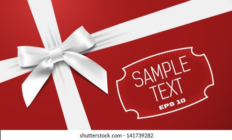 white bow on a red textural background