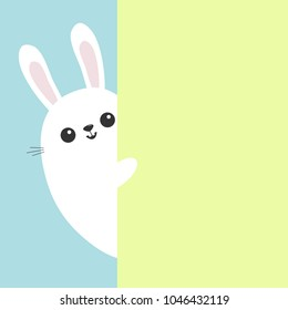 White bunny rabbit holding green wall signboard. Cute cartoon funny animal hiding behind paper. Happy Easter symbol. Peekaboo. Flat design. Pastel blue color background. Vector illustration