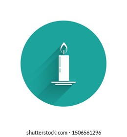White Burning candle in candlestick icon isolated with long shadow. Old fashioned lit candle. Cylindrical candle stick with burning flame. Green circle button. Vector Illustration