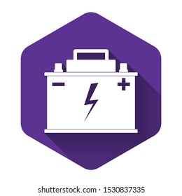 White Car battery icon isolated with long shadow. Accumulator battery energy power and electricity accumulator battery. Lightning bolt symbol. Purple hexagon button. Vector Illustration
