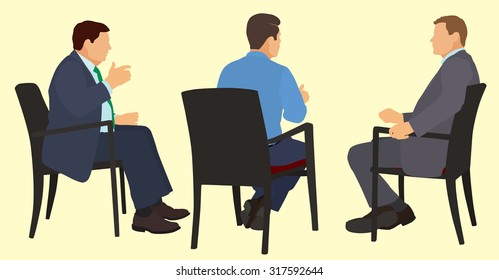 White or Caucasian American Businessman Sitting in Chairs Having a Meeting