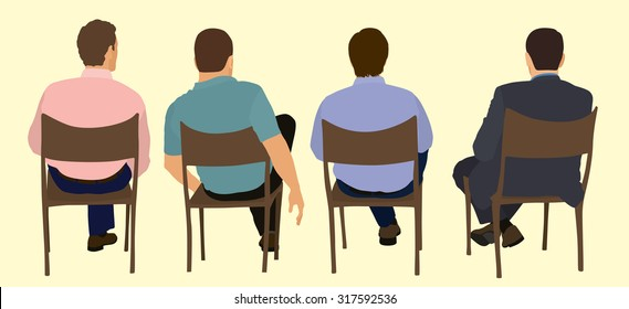 White or Caucasian Sitting in Chairs Viewed from the Back