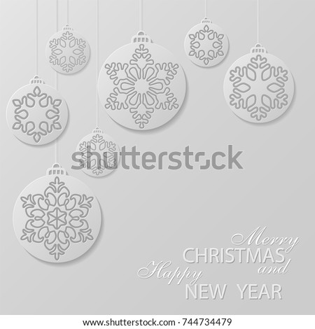 white christmas balls with a snowflakes cut out of paper decorative design elements holiday