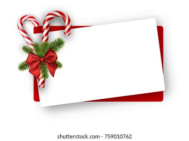 White Christmas card with candy canes and bow. Vector paper illustration.
