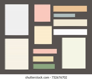White and colorful striped paper, copybook, notebook sheets for note or message stuck on dark brown background.