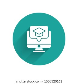 White Computer monitor with graduation cap icon isolated with long shadow. Online learning or e-learning concept. Green circle button. Vector Illustration