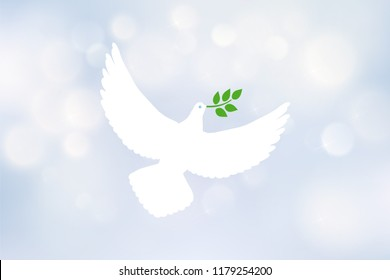 White dove carrying leaf branch and international day of peace. World Water Day. Vector image on blue blurred defocused background with bokeh ligth