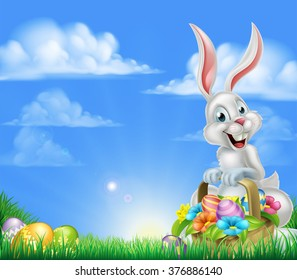 White Easter bunny with a basket full of decorated chocolate Easter eggs in a field