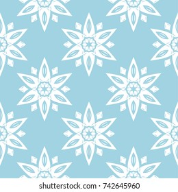 White floral ornament on blue background. Seamless pattern for textile and wallpapers