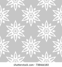 White floral ornament on gray background. Seamless pattern for textile and wallpapers