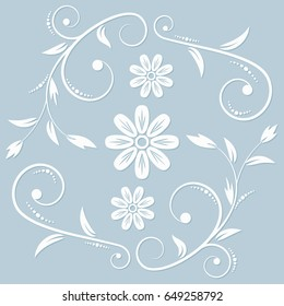 The white floral ornament on the light blue background. Cut from a papper.
