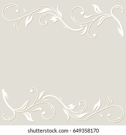 The white floral ornament on the light cream background. Cut from paper.