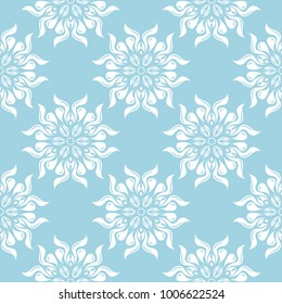 White flowers on blue background. Ornamental seamless pattern for textile and wallpapers
