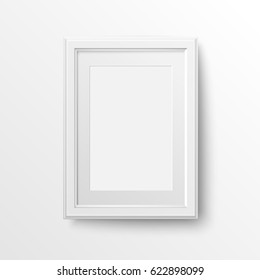 White frame for photos.Vertical blank picture frame with passe-partout. Vector realistic paper or matte plastic white with shadow. Isolated picture frame mockup template on white background