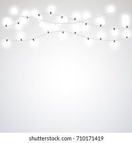White garland style Christmas lights on the gray background. Vector design element.