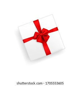 White gift box tied with silk or satin ribbon. Vector isolated stock illustration of a gift with a red bow on a white background in a realistic style. The view from the top. flat lay