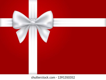 White gift ribbon and bow on red background.
