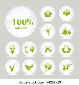 White glass balls with green symbols
