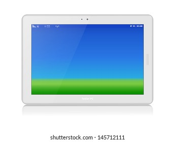White glossy tablet personal computer in horizontal orientation of display. Green grass and blue sky as screen background. Copy space.