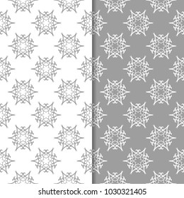 White and gray set of floral backgrounds. Seamless patterns for textile and wallpapers