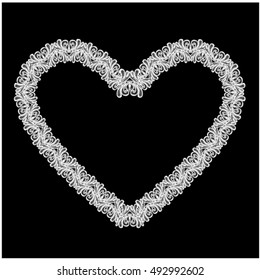 White Heart shape is made of lace doily isolated on black background. Frame element for Holiday Card, Valentines Day, Wedding invitation.