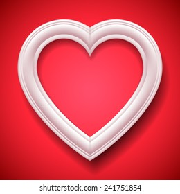 White heart shaped picture frame on red background