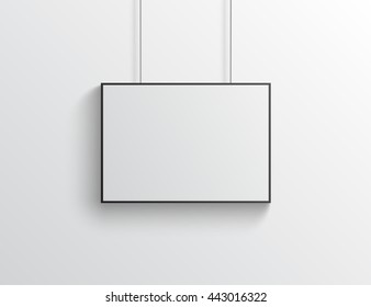 White horizontal poster with black frame mockup on grey wall
