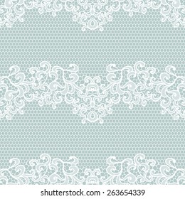 White lace seamless pattern with flowers on blue background