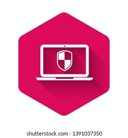 White Laptop protected with shield symbol icon isolated with long shadow. Internet security concept. PC security, firewall technology, privacy safety. Pink hexagon button. Vector Illustration