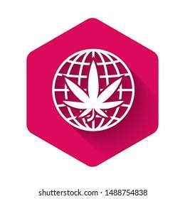 White Legalize marijuana or cannabis globe symbol icon isolated with long shadow. Hemp symbol. Pink hexagon button. Vector Illustration