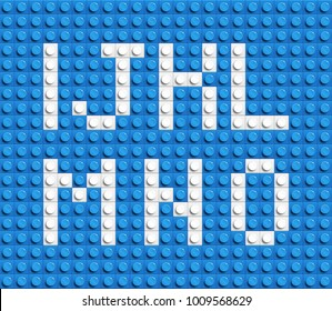 White letters of alphabet from blue building lego bricks. lego bricks letters. blue lego background