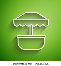 White line Attraction carousel icon isolated on green background. Amusement park. Childrens entertainment playground, recreation park.  Vector Illustration