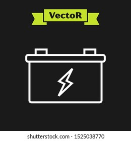 White line Car battery icon isolated on black background. Accumulator battery energy power and electricity accumulator battery.  Vector Illustration